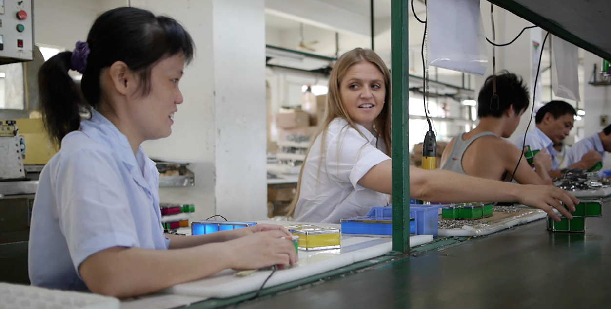 Taryn Sullivan, COO of Dexter Industries on an assembly line in a Chinese factory.