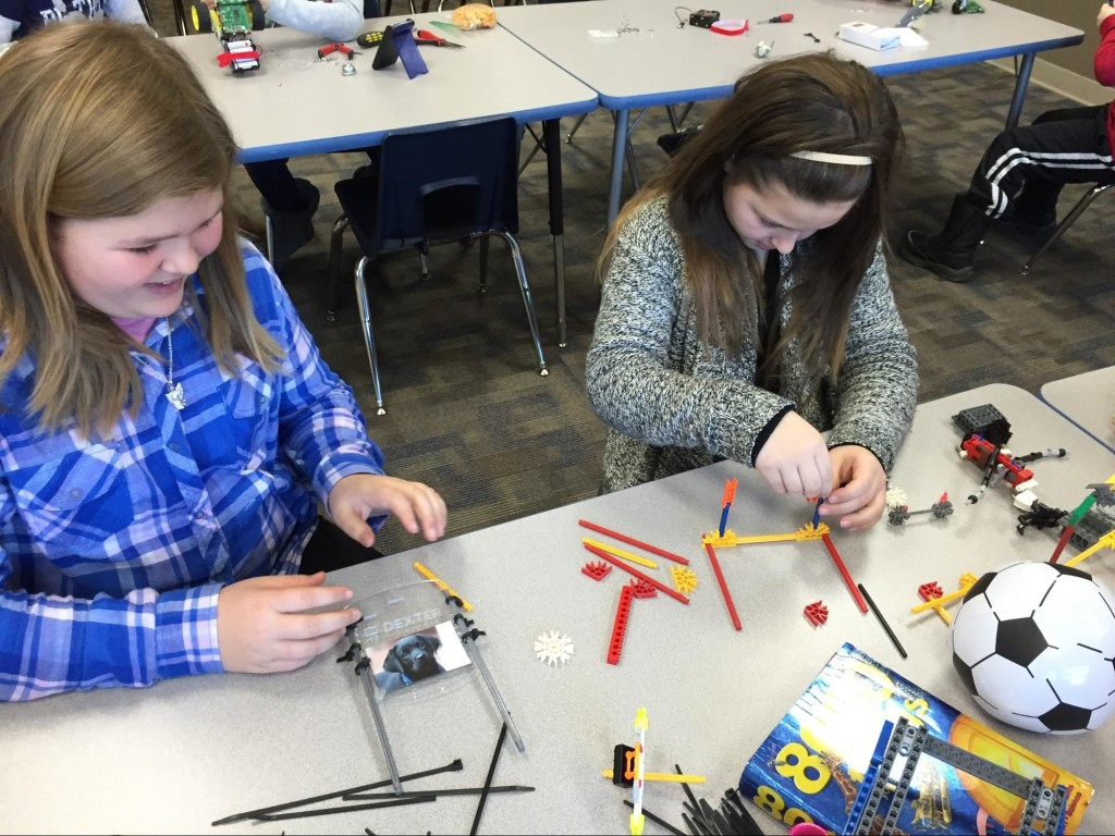 """Makayla and Emily designing """"arms"""" and attachment methods."""