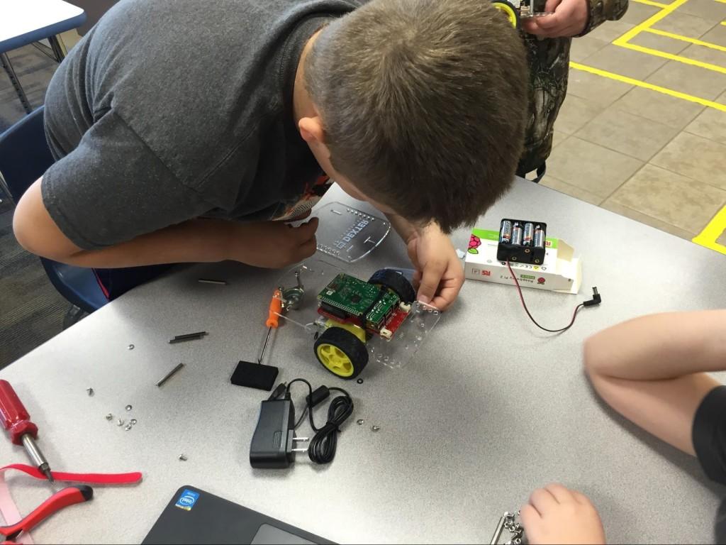 Assembling the GOPIGO 2 with help from the Dexter Industries website.