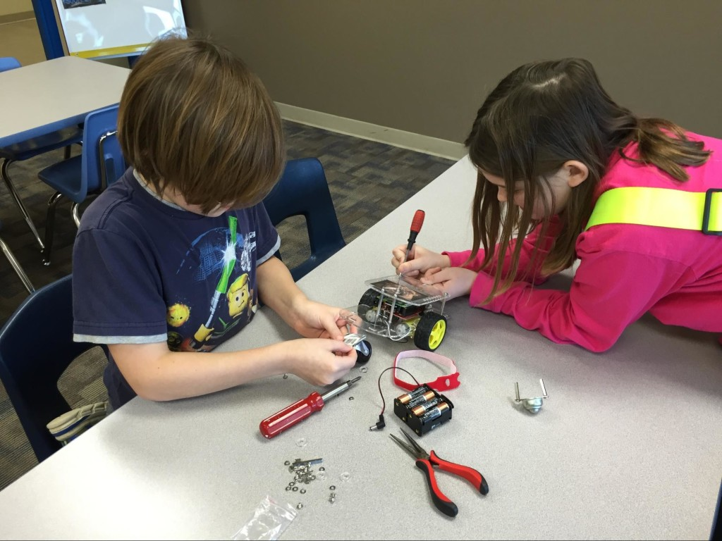 Landon and Riley attaching the new caster wheel